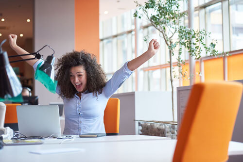 An image of a business owner excited about the Business Branding Services from Not Fade Away.