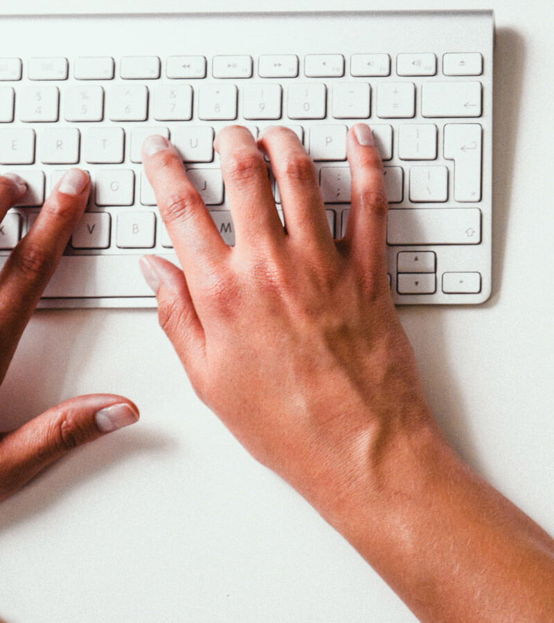 An image of a copywriter creating content for a web design solutions project.
